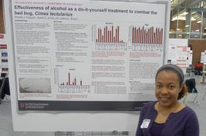 Student with poster at Denman Undergrad Research Forum